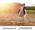 8 Year Boy Riding White Horse...