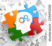 Stock photo psychological concept profile of head with cogwheel gear mechanism located on multicolor puzzle 159693200