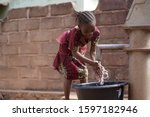 Young African Girl Cleaning He...
