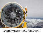 snow making machine on piste at ... | Shutterstock . vector #1597367923