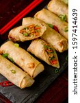 Small photo of Egg rolls or spring rolls fried.Traditional Chinese Thai restaurant appetizer, spring rolls or egg rolls. Made from wonton wrappers and filled with Chinese veggies and served w/ chili dipping sauce.