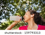 content sporty woman drinking... | Shutterstock . vector #159793313