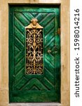 Old Wooden Green Door With A...