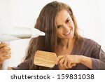 happy young woman brushing and... | Shutterstock . vector #159831038