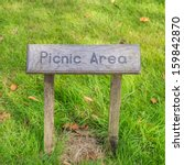 A Shot Of A Picnic Area Sign.