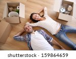 young adults moving in new home | Shutterstock . vector #159864659