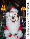 Small photo of Baku, Azerbaijan - 24.12.2019 .Santa Claus became Mickey Mouse .Santa Claus 2020 . Mickey Mouse 2020 .