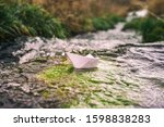 Paper Boat In A Brook As A...