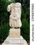 Small photo of ATHENS, GREECE - SEPTEMBER 27, 2019: Torso statue of Hadrian that originally stood in front of the Stoa of Zeus. It now sits at the foot of Kolonos Hill, ancient Agora of Athen