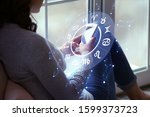 Small photo of Young woman with mobile phone reading astrological forecast at home