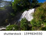 huluganga falls is a waterfall... | Shutterstock . vector #1599834550