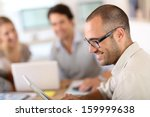 young man in office working on... | Shutterstock . vector #159999638