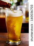 beer pouring into glass in a bar | Shutterstock . vector #160036703