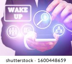 Small photo of Text sign showing Wake Up. Conceptual photo an instance of a demonstrating waking up or being woken up Rise up.