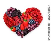 Small photo of A variety of summer berries in the shape of heart as a symbol of valentine and love.
