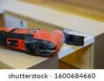 Small photo of Electric cordless oscillating multi function power cutting tool