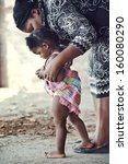 African Mother Teaching Baby T...