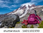 Small photo of Osprey Backpack, Mt Rainier NP, WA - September 10, 2019: resting after strenuous hike at Mt Rainier.