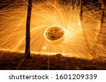 Fire circle spinning from steel wool creating spiral spark, Steel wool spinning fire circle spinning from steel wool creating spiral spark, birch grove