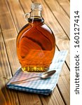 maple syrup in glass bottle on... | Shutterstock . vector #160127414