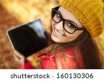 Smiling Young Woman Using...