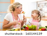 kid daughter feeding mother... | Shutterstock . vector #160144139