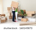 couple kissing with box on... | Shutterstock . vector #160145873