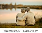 happy senior couple sitting in... | Shutterstock . vector #160164149