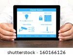 businessman holding a tablet... | Shutterstock . vector #160166126