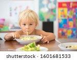 Sweet Toddler Boy  Eating...