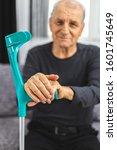 elderly person standing with... | Shutterstock . vector #1601745649
