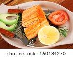healthy food  hot baked salmon... | Shutterstock . vector #160184270