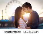 romantic couple in front of... | Shutterstock . vector #160219634