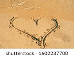 Heart Shape Drawing In The Sand ...