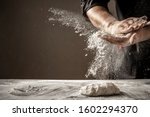 Small photo of Photo of flour and men hands with flour splash. Cooking bread. Kneading the Dough.