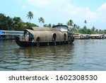 House boat wading through Alappuzha lake in Kerala
