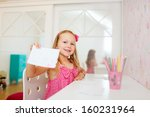 adorable little girl in her room | Shutterstock . vector #160231964