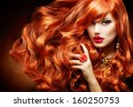 Long Curly Red Hair. Fashion...