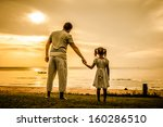 Father And Daughter Standing A...
