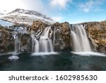 Small photo of Waterfall behind Kirkjufell in Iceland on a blustery March day.
