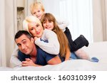 happy family lying on top of... | Shutterstock . vector #160310399