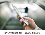 woman using her cell phone in...   Shutterstock . vector #160355198
