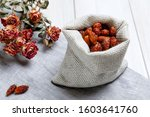 A Linen Bag With Dried Rose...