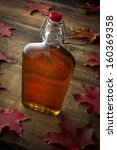 Organic Maple Syrup On Wooden...