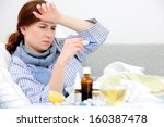 sick woman  lying in bed with... | Shutterstock . vector #160387478