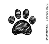 dog paw doodle  hand drawn...   Shutterstock .eps vector #1604074573