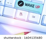 Small photo of Conceptual hand writing showing Wake Up. Business photo text an instance of a demonstrating waking up or being woken up Rise up.
