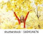 happy woman in autumn park drop ... | Shutterstock . vector #160414676