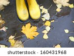 Feet In Yellow Rubber Boots...