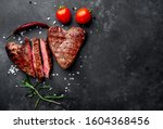 Two Grilled Beef Steaks In The...